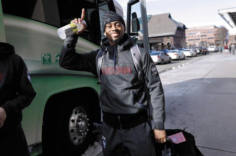 UConn's Ryan Boatright gestures toward members of the media before boarding a bus to the airport to depart for Dallas on Tuesday night. The Huskies play Florida in the Final Four on Saturday.