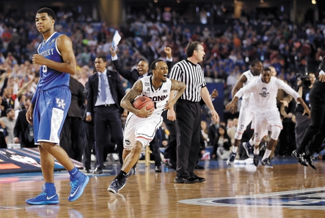 UConn's Ryan Boatright, center, clutches the basketball and Kentucky's Andrew Harrison, left, walks away as time runs out in UConn's 60-54 victory over Kentucky on Monday night in the NCAA championship game at AT&T Stadium in Arlington, Texas. It was the program's fourth national title since 1996 and first for second-year coach Kevin Ollie.
