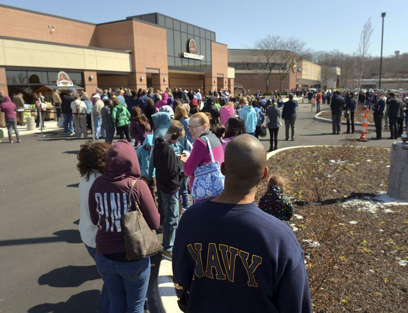 Military families wait in line Wednesday for the grand opening of the new commissary at the Naval Submarine Base in Groton.