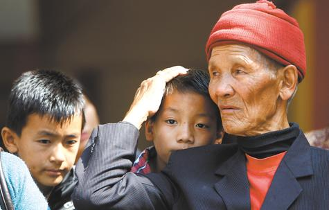 The father and sons of Nepalese mountaineer Ang Kaji Sherpa, killed in an avalanche on Mount Everest, wait for his body to arrive at a Sherpa Monastery in Katmandu, Nepal, on Saturday.