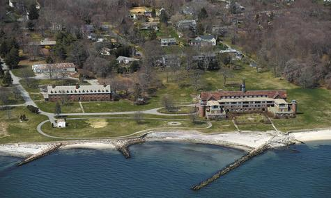 The two buildings designed by famed architect Cass Gilbert are prominent in this aerial photo taken Friday of the vacant Seaside property in Waterford. The longtime  preferred developer is proposing amendments to the town's zoning regulations that would allow the construction of an inn on the waterfront property.