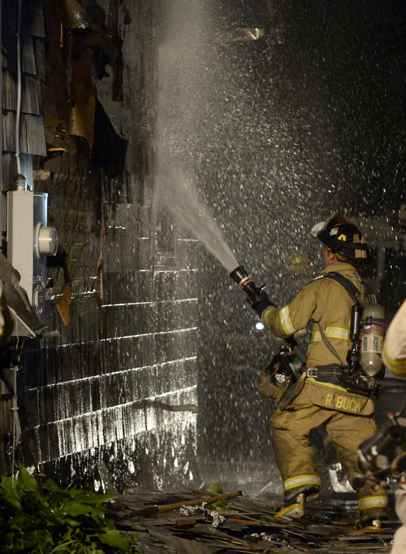 Firefighters battle a structure fire at 31 S. Broad St. in Pawcatuck, Sunday, June 1, 2014.