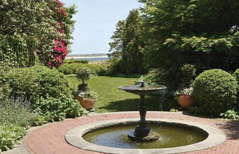 A backyard fountain on Main Street with a view of Little Narragansett Bay is part of the Stonington Garden Club's garden tour.