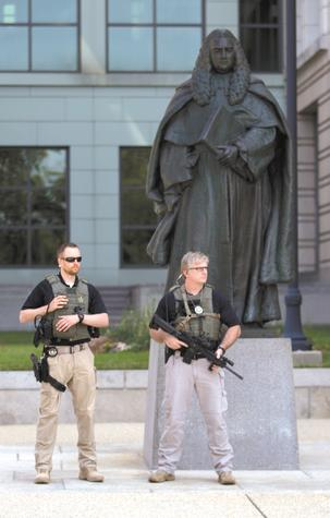 U.S. marshals monitor the area near U.S. District Court in Washington on Saturday after security was heightened in anticipation of a court appearance by captured Libyan militant Ahmed Abu Khattala. Khattala is accused of being the mastermind behind the deadly attack on the U.S. consulate in Benghazi, Libya, in 2012.