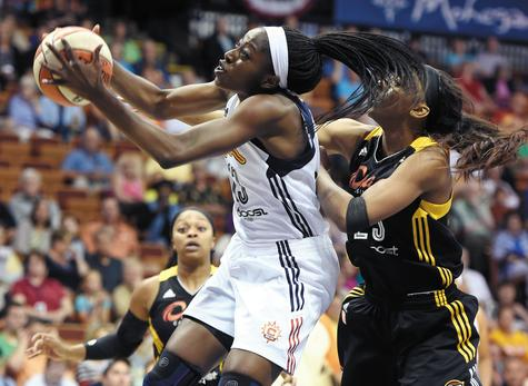 Chiney Ogwumike of the Connecticut Sun, left, beats Tulsa's Glory Johnson to a rebound in the first half of Thursday's WNBA game at Mohegan Sun Arena. The Shock won the game 96-83, the Sun's fourth straight loss.