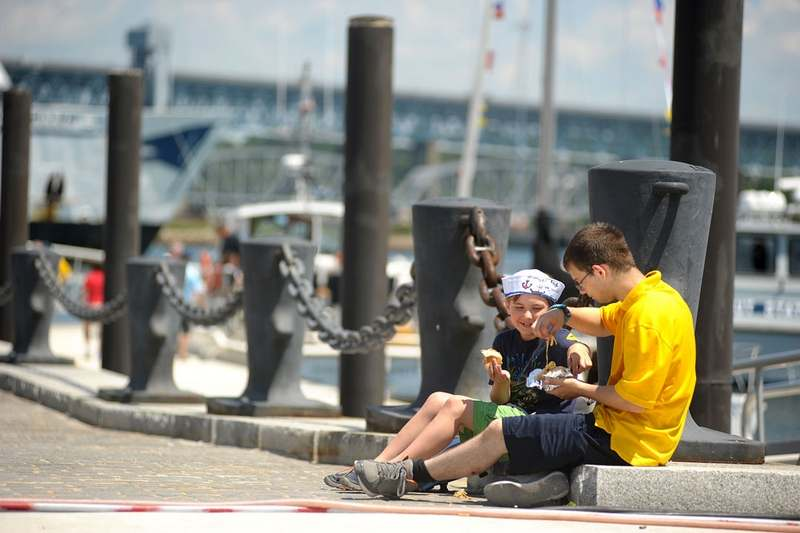 Above, Sea Scout Frankie Card, 16, of Portland, right, and Sea Scout helper Josh Maxwell, 7, of Chester eat a snack at New London's City Pier after disembarking their ship.