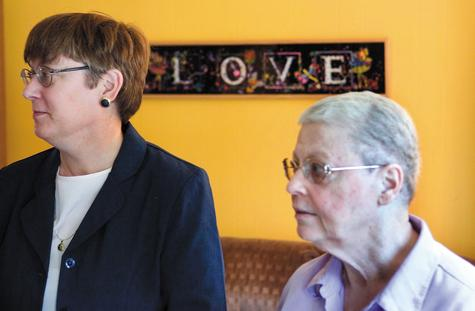 Margaret Mueller, right, and Charlotte Stacey, shown at their Norwalk home in 2006. The state Supreme Court ruled Wednesday that some legal rights of same-sex couples predate the state's approvals of civil unions and gay marriage.