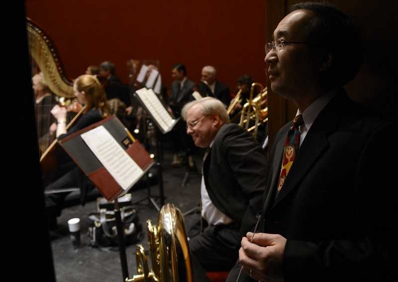 Eastern Connecticut Symphony Orchestra conductor Toshiyuki Shimada waits backstage as the ECSO warms up prior to the first of two Young People's Concerts Thursday, Nov. 20, 2014,  at the Garde Arts Center in New London