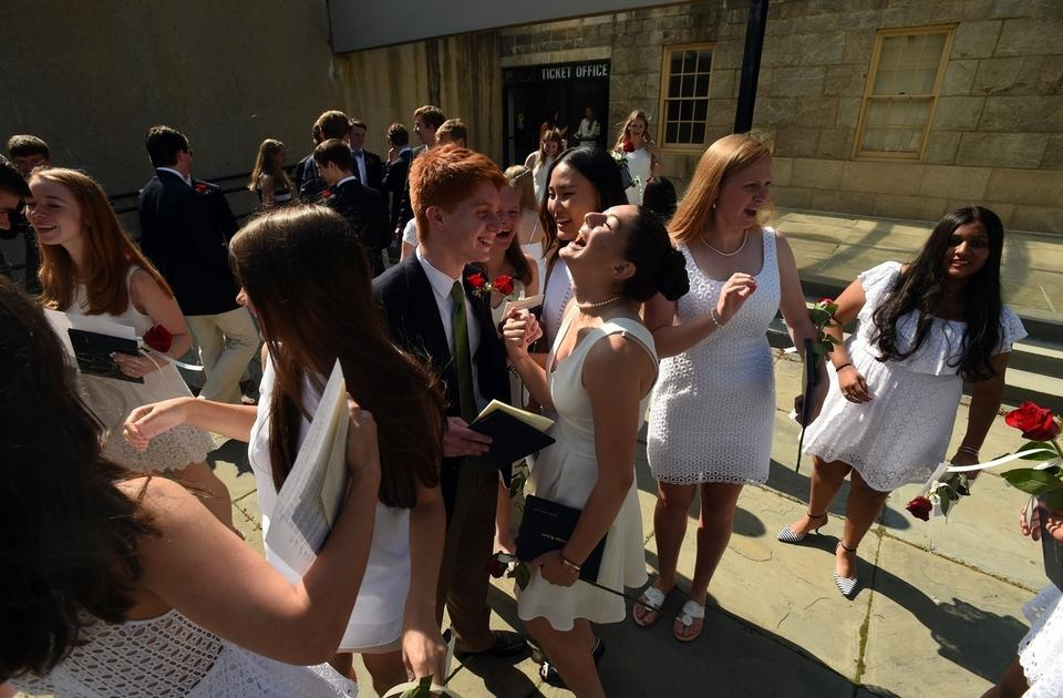 Joshua Goldstein, center left, of East Lyme and Maddy Lahm, center right, of Lyme and their fellow graduates celebrate outside the Palmer Auditorium after The Williams School graduation ceremony on the Connecticut College campus in New London Wednesday, June 10, 2015.  (Dana Jensen/The Day)