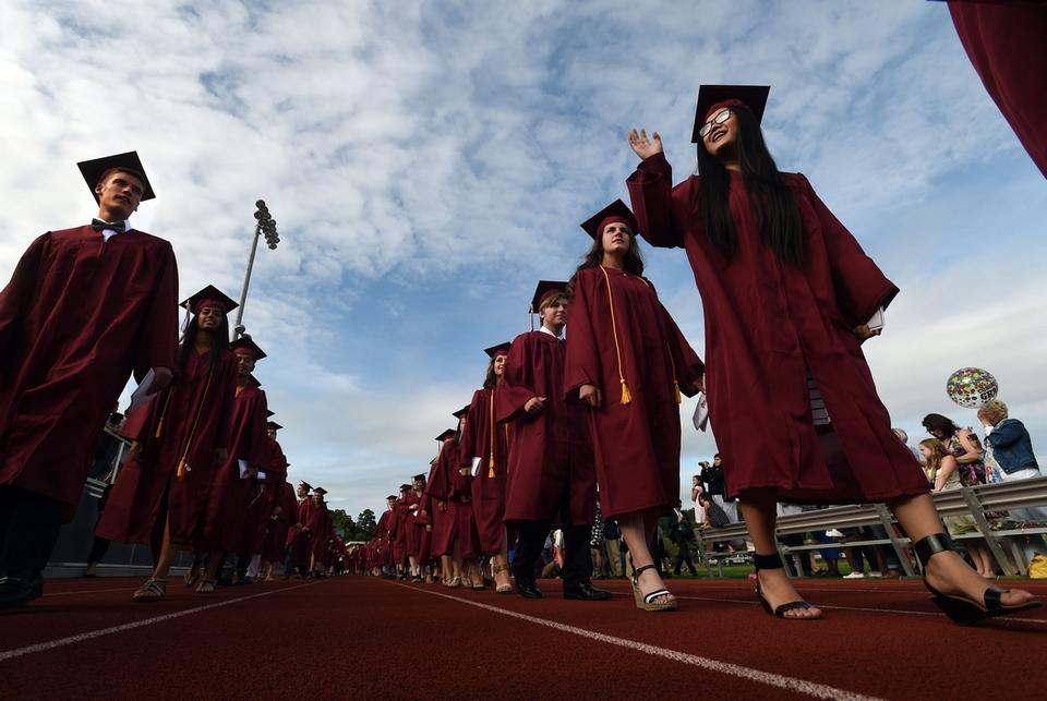 The processional passes the crowd in the stands and on the field during the East Lyme High School graduation ceremony Thursday, June 18, 2015.  (Dana Jensen/The Day)