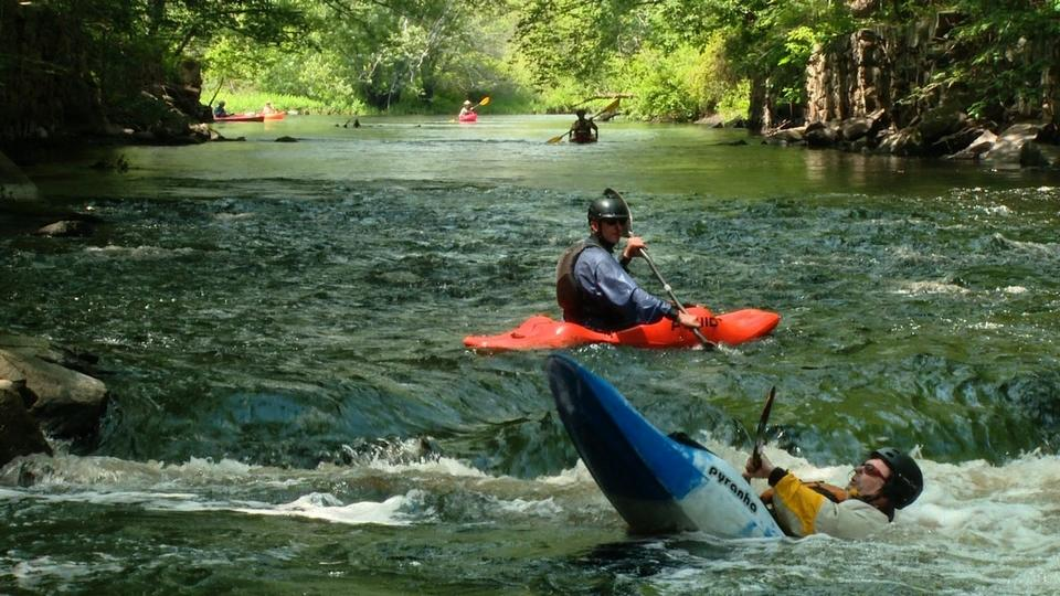 Chris Dey of Stonington, foreground, and Glen Gellow of Fishers Island paddle in the whitewater of the White Rock Dam mill race on June 14 on the Pawcatuck River. The popular paddling spot is slated to disappear with the dam's upcoming removal. (Peter Huoppi/The Day)