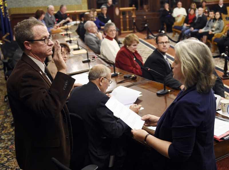 Norwich city clerk Betsy Barrett administers to the oath of office to new city council president pro ten Peter Nystrom Tuesday, December 1, 2015 at Norwich City Hall.  (Sean D. Elliot/The Day)