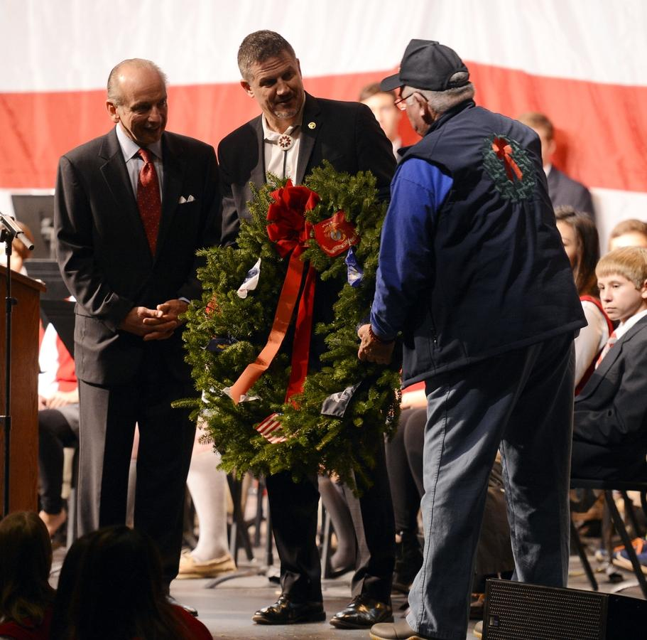Wayne Hanson, Chairman of Wreaths Across America, right, presents a wreath to St. Bernard School headmaster Don Macrino, left, and Mohegan Tribal Chairman Kevin Brown during a stop on the tour at St. Bernard Tuesday, December 8, 2015.  (Sean D. Elliot/The Day)