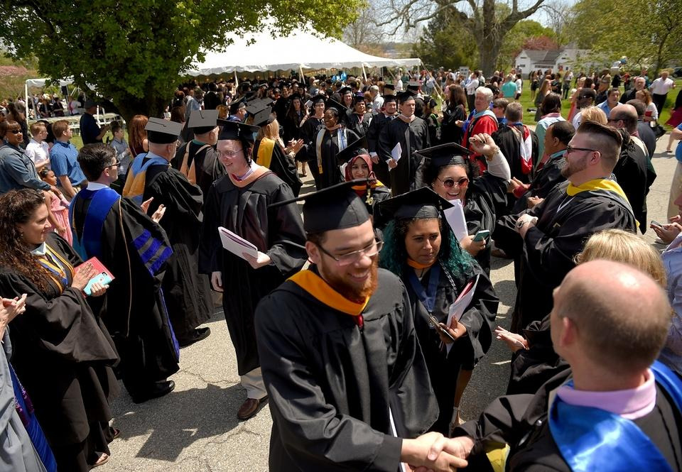 Members of the Mitchell College Class of 2016 exit the 72nd Commencement Ceremony lined by Mitchell faculty and staff members at the college campus in New London on Saturday, May 14, 2016.   (Tim Cook/The Day)