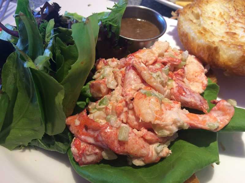 Barely dressed lobster salad nestled onto a buttered and grilled croissant lined with a lettuce leaf at the Olympia Tea Room in Watch Hill. (Jill Blanchette/The Day)