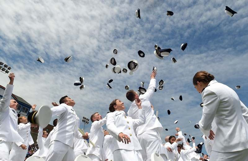 Ensigns toss their old caps and shoulder boards in the air at the end of the United States Coast Guard Academy graduation in New London Wednesday, May 18, 2016.   (Dana Jensen/The Day)