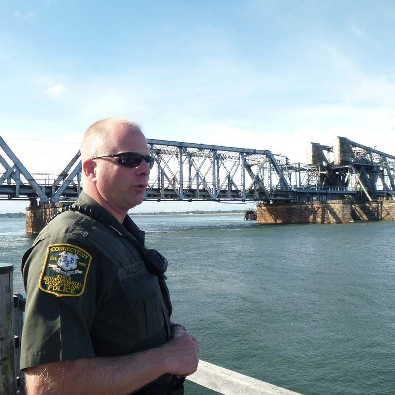 Capt. Keith Williams, head of the marine division of the state Department of Energy and Environmental Protection´s EnCon police, talks about his new position while walking the fishing pier at DEEP Marine Headquarters in Old Lyme on Thursday. (Judy Benson/The Day)