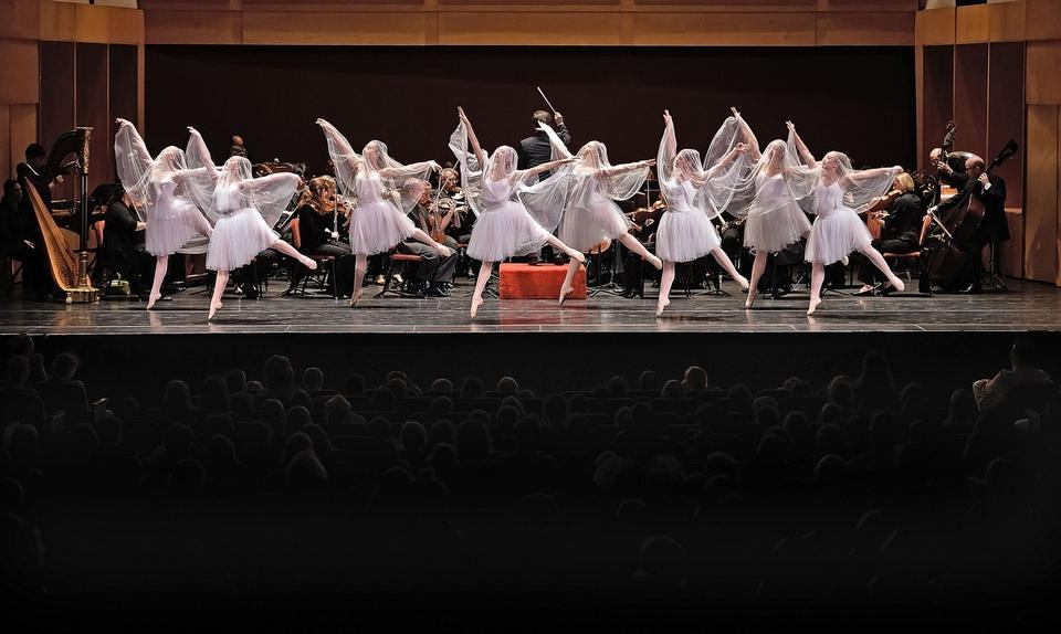 Eastern Connecticut Ballet dancers leap across the stage as Eastern Connecticut Symphony Orchestra Music Director Toshiyuki Shimada conducts the orchestra during its annual Young People´s Concerts on Tuesday, October 18, 2016, at the Garde Arts Center in New London. Sponsored by the Community Foundation of Eastern Connecticut, Chelsea Groton Foundation, Bodenwein Public Benevolent Foundation, and Charter Oak Federal Credit Union, over 1500 3rd-5th grade students from Norwich, New London, Groton, and other school districts were treated to, Chills & Trills. This 50-minute concert featured some familiar Halloween-themed music including Mussorgsky´s Night on Bald Mountain and Grieg´s In the Hall of the Mountain King from Peer Gynt. The Eastern Connecticut Ballet joined ECSO with Saint-Saëns´ Danse Macabre and selections from Tchaikovsky´s Sleeping Beauty. The program ended with a tribute to John Williams that highlighted many of Williams´ movie compositions. New this year for these YPCs, ECSO offered in-school presentations of some of the material that was provided in study guides, and on the concert stage. A grant from the Community Foundation of Eastern Connecticut allowed the ECSO Concertmaster Stephan Tiezan and Principal Cellist Christine Coyle to travel to Elementary schools in the region, performing excerpts and break down concepts musically to further prepare students to make the most of their YPC experience.  (Sean D. Elliot/The Day)
