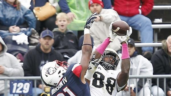 Central Florida tight end Jordan Akins, right, catches a touchdown pass over the defense of UConn cornerback John Robinson IV during the second quarter of Saturday's game in East Hartford. (Stew Milne/AP Photo)