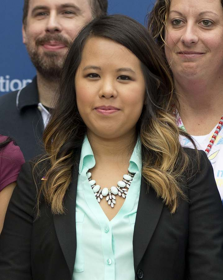In this Oct. 24, 2014 file photo, nurse Nina Pham poses for a photo at the National Institutes of Health (NIH) in Bethesda, Md. Pham, who contracted Ebola while caring for the first person in the U.S. diagnosed with the deadly disease, has settled a lawsuit against the parent company of the Dallas hospital where she worked. (AP Photo/Pablo Martinez Monsivais, File)