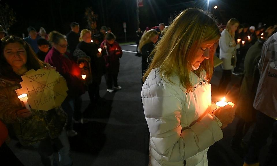 Community Speaks Out co-founder Lisa Cote Johns holds a candle for her son Christopher who she lost to opioid addiction as Community Speaks Out hosts a candlelight vigil honoring victims and families who are struggling with opioid addiction in Montville on Thursday, Dec. 1, 2016.  (Tim Cook/The Day)