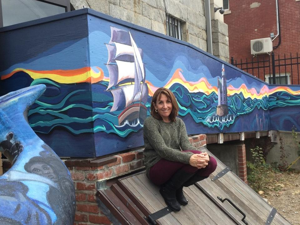Christina Corcoran painted a mural on the back wall of the Custom House Maritime Museum in New London. She was named New Volunteer of the Year by the New London Maritime Society on Nov. 13. (photo submitted)