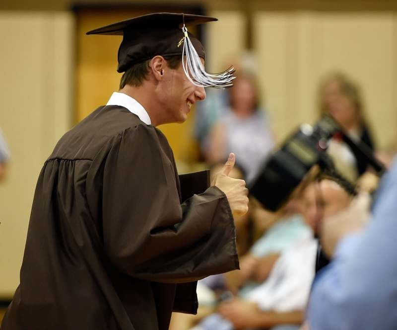 Stonington High School graduate William Cavaliere gives a thumbs-up after accepting his diploma during commencement exercises Friday, June 16, 2017. (Sean D. Elliot/The Day)