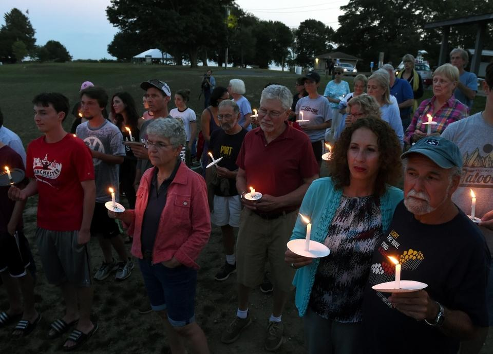 People participate in the candlelight vigil for the Charlottesville victims at McCook Point Park in Niantic Wednesday, Aug. 16, 2017.  (Dana Jensen/The Day)