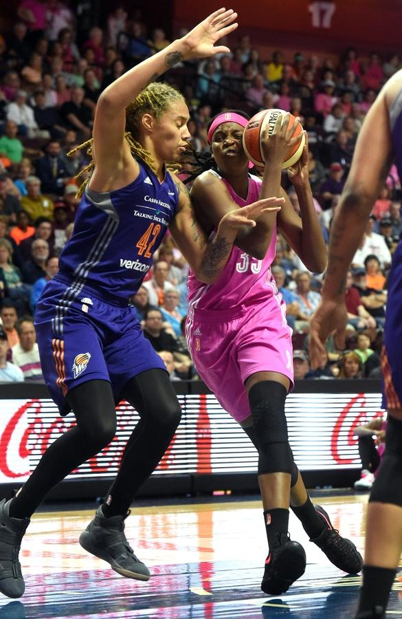 Jonquel Jones (35) of the Connecticut Sun is fouled by Brittney Griner (42) of the Phoenix Mercury as she drives toward the basket during Sunday's WNBA game at Mohegan Sun Arena.  (Dana Jensen/The Day)