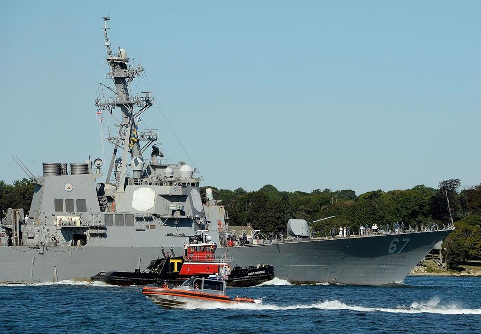 A U.S. Coast Guard 29-foot response boat-small, foreground, patrols the waters of the Thames River off Groton as the U.S. Navy Arleigh Burke class guided missile destroyer USS Cole (DDG 67) arrives in New London harbor en route to Fort Trumbull State Park Friday, September 8, 2017 for the Connecticut Maritime Heritage Festival. The Cole will be open for tours at Fort Trumbull State Park through the weekend.  (Sean D. Elliot/The Day)