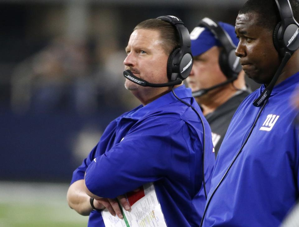 Giants head coach Ben McAdoo watches play in the closing minutes of Sunday night's 19-3 loss to the Dallas Cowboys in Arlington. (AP Photo/Michael Ainsworth)