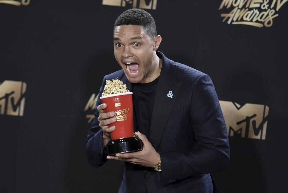 Trevor Noah poses with the award for best host for