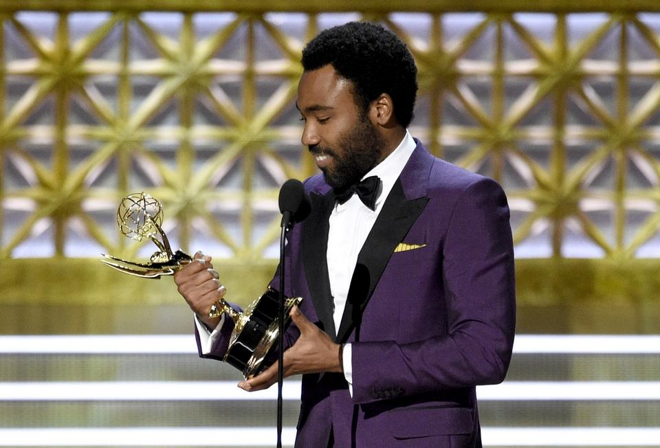 Donald Glover accepts the award for outstanding directing for a comedy series for the 'Atlanta' episode 'B.A.N.' at the 69th Primetime Emmy Awards on Sunday, Sept. 17, 2017, at the Microsoft Theater in Los Angeles. (Photo by Chris Pizzello/Invision/AP)