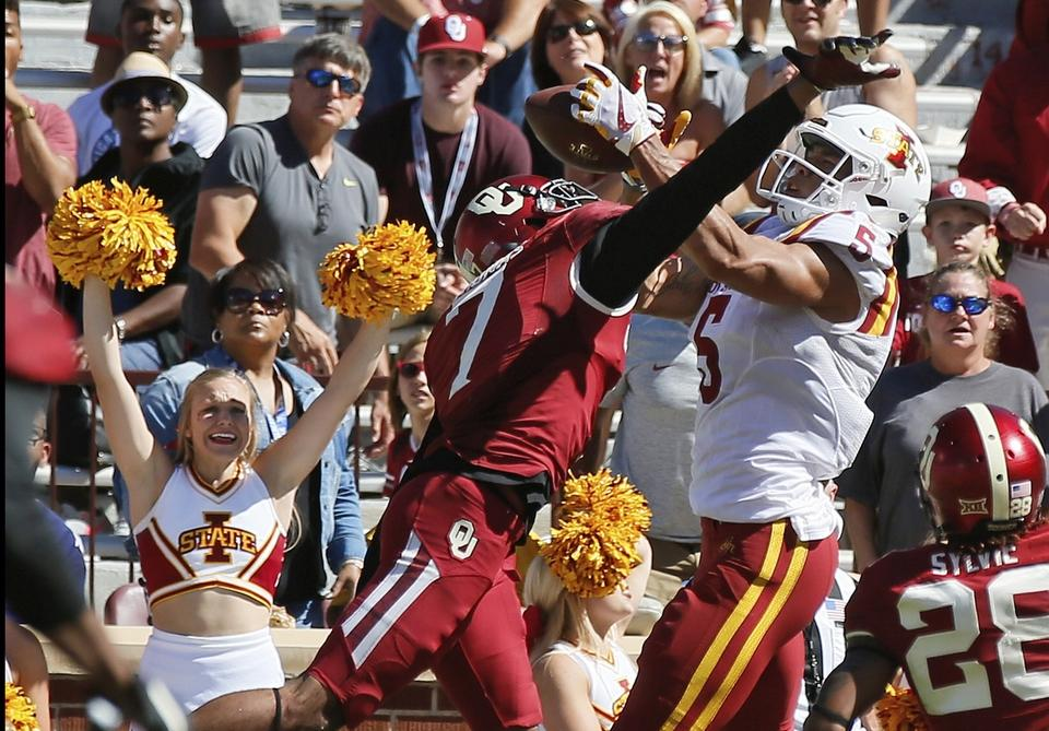 Iowa State's Allen Lazard catches the game-winning touchdown between Oklahoma's Jordan Thomas (7) and Chanse Sylvie with 2:19 left in Saturday's game in Norman, Okla. Iowa State upset the No. 3 Sooners, 38-31. (Sue Ogrocki/AP Photo)