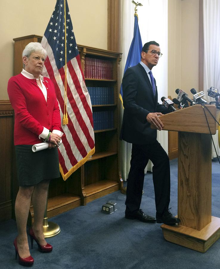 Democratic Gov. Dannel P. Malloy, right, and Lt. Gov. Nancy Wyman speak with reporters, Monday, Oct. 16, 2017, in Hartford, Conn., about the fourth revised state budget that Malloy released Monday. Malloy said he hopes to help speed along closed-door budget talks between Democratic and Republican legislative leaders at the state Capitol. (AP Photo/Susan Haigh)