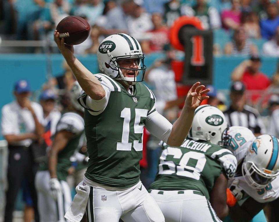 Jets quarterback Josh McCown looks to pass during the first half on Oct. 22 against the Dolphins in Miami Gardens, Fla. The Carolina Panthers play the Jets on Sunday.  Both the Panthers and Jets are coming off bye-week breaks, so they're well-rested. (AP Photo/Wilfredo Lee, File)
