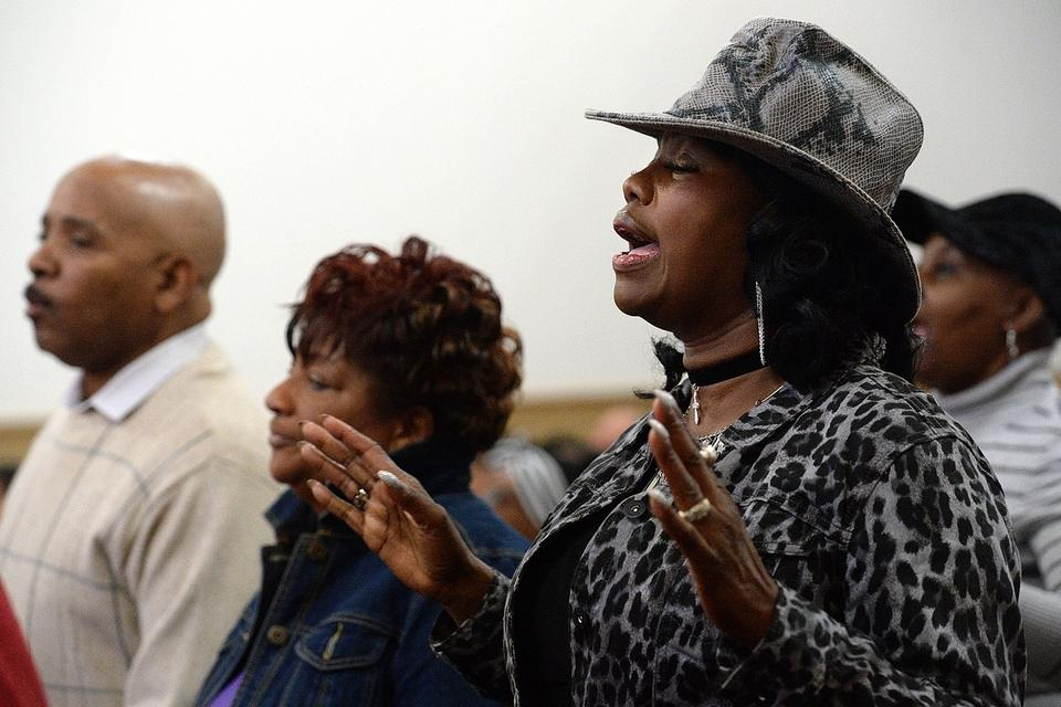 Tawanda Miller, right, of New London, and other members of the congregation sing during the service at Shiloh Baptist Church after the annual Martin Luther King March from New London City Hall, Monday, Jan. 15, 2018.  (Dana Jensen/The Day)