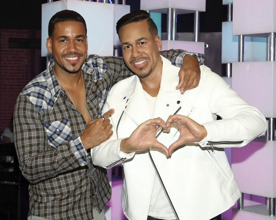 Singer-songwriter Romeo Santos, left, unveils his wax figure at Madame Tussauds on Wednesday, July 19, 2017, in New York. (Photo by Greg Allen/Invision/AP)
