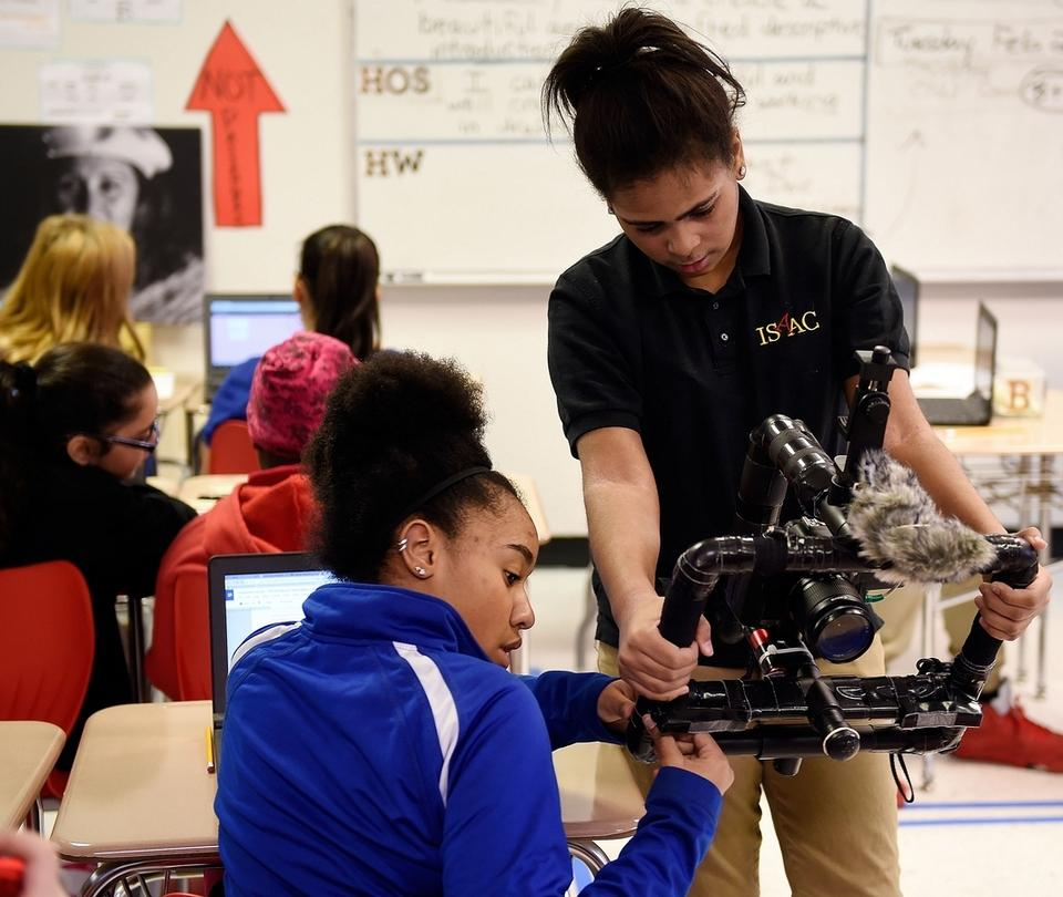 Keyonna Hayes, 11, left, helps Jalisa Diaz, 11, set-up the class' camera to record video as students in Mike Kuczenski's sixth grade social studies class at the Interdistrict School for Arts and Communication (ISAAC) work on their ongoing project looking at immigration, Wednesday, Feb. 21, 2018. (Sean D. Elliot/The Day)