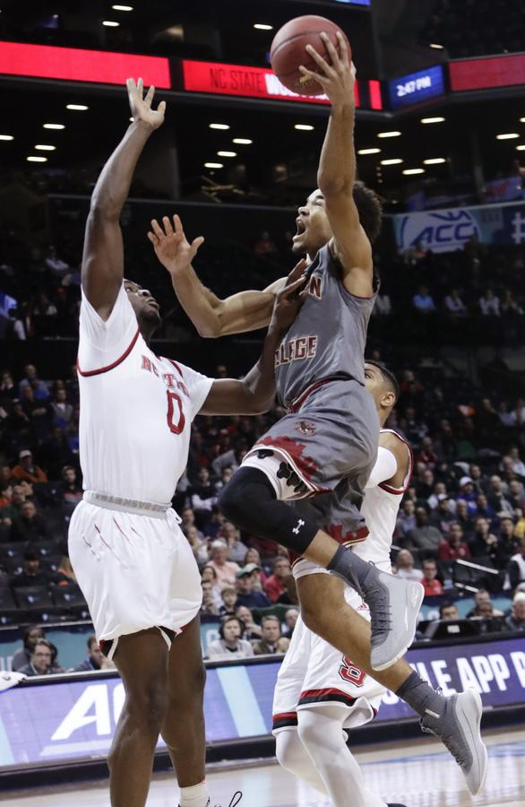 Boston College's Jerome Robinson drives past North Carolina State's Abdul-Malik Abu during the first half of Wednesday's Atlantic Coast Conference tournament second round game at Barclays Center. Boston College upset the Wolfpack, 91-87. (Frank Franklin II/AP Photo)