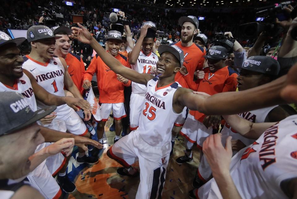 Virginia players celebrate after defeating North Carolina in the championship game of the Atlantic Coast Conference tournament on Saturday at New York. (AP Photo/Julie Jacobson)