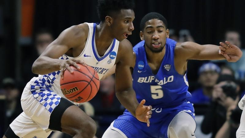 Kentucky guard Hamidou Diallo, left, drives past Buffalo guard CJ Massinburg (5) during the NCAA tournament game on March 17 at Boise, Idaho. Diallo is a former Putnam Science Academy standout. (AP Photo/Ted S. Warren)