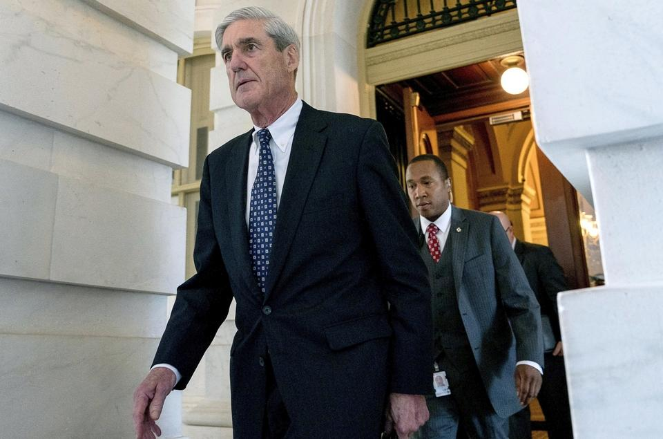 In this June 21, 2017, file photo, former FBI Director Robert Mueller, the special counsel probing Russian interference in the 2016 election, departs Capitol Hill following a closed door meeting in Washington. It was one year ago Thursday when Robert Mueller, the former FBI director, was appointed as special counsel to take over the Justice Department's investigation into possible coordination between Russia and Donald Trump's 2016 presidential campaign. (AP Photo/Andrew Harnik, File)