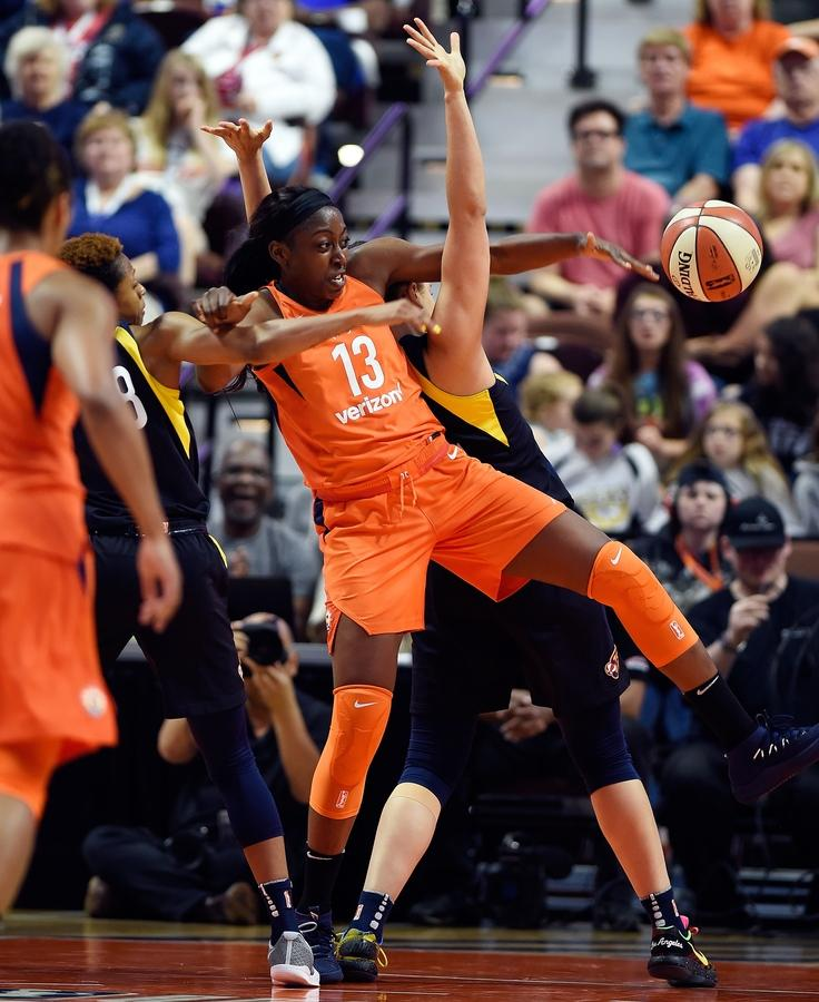 Connecticut Sun forward Chiney Ogwumike (13) tangles with Indiana Fever center Natalie Achonwa, back, and guard Tiffany Mitchell, left, for a rebound in the second half of Saturday's WNBA matchup at Mohegan Sun Arena. The Sun ran their record to 3-0 with the 86-77 victory over the Fever. (Sean D. Elliot/The Day)
