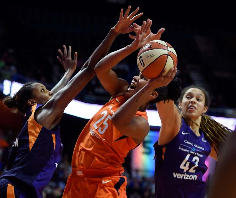 Connecticut Sun forward Alyssa Thomas, middle, is fouled by Phoenix Mercury center Brittney Griner (42) as Angel Robinson, left, defends in the second half of Friday night's Sun victory at Mohegan Sun Arena. (Sean D. Elliot/The Day)