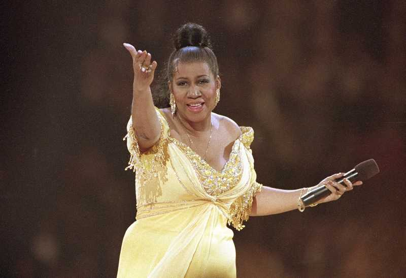 In this Jan. 19, 1993 file photo, singer Aretha Franklin performs at the inaugural gala for President Bill Clinton in Washington.  Franklin died Thursday at her home in Detroit.  She was 76. (AP Photo/Amy Sancetta, File)