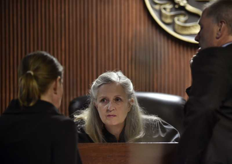 Judge Barbara Bailey Jongbloed, center, of the New London District Superior Court, speaks with state prosecutor Christa L. Baker, left, and defendant attorney Walter D. Hussey during the first day of the murder trial of Dante A. Hughes in courtroom 3 of the New London Superior Court on July 11, 2018. Jongbloed questioned jurors from the trial Tuesday, Sept. 4, 2018, after one member reported that another had looked up the definition of manslaughter in a dictionary, despite the judge's instructions not to do so. (Tim Martin/The Day)