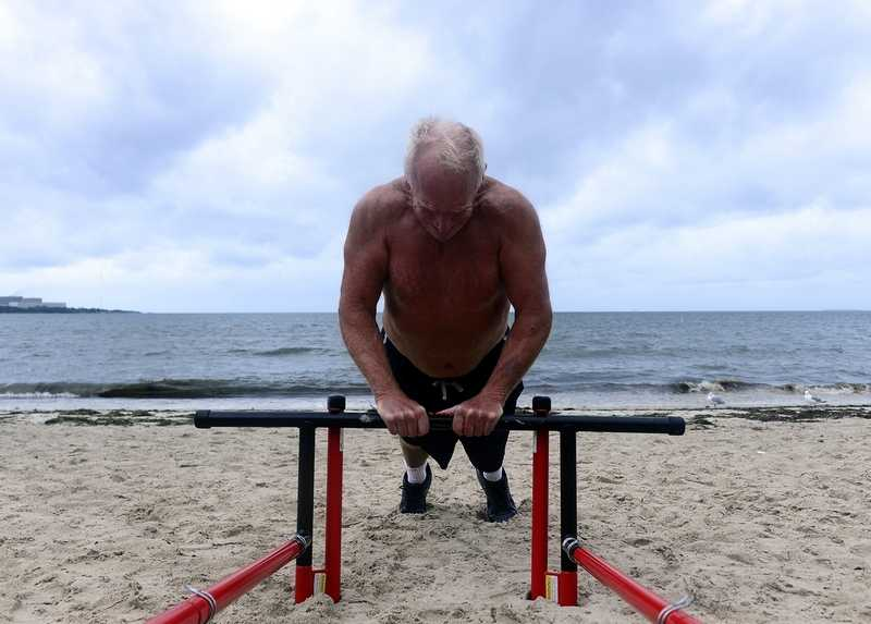Jay Montmeat, of Old Lyme works out on Monday, Sept. 10, 2018 at Hole in the Wall Beach in Niantic.