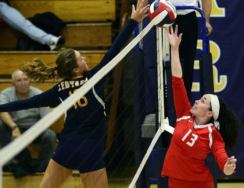 Norwich Free Academy's Bella Llano, right, meets Ledyard's Katie Krupansky at the net during Monday night's high school volleyball match at Ledyard. NFA beat the Colonels 3-0. (Sarah Gordon/The Day)