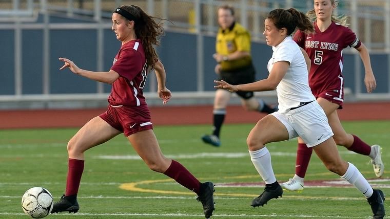 East Lyme's Alivia Catanzaro, left, sprints away from NFA's Natalie Dionne during Thursday night's ECC Division I girls' soccer game at East Lyme. The Vikings and Wildcats played to a 1-1 double overtime draw. (Dana Jensen/The Day)